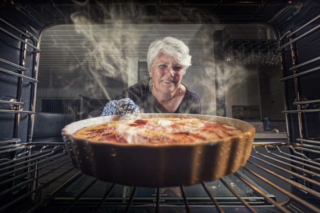 Woman is cooking pie